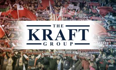 the kraft group logo on the foreground of a cheering crowd
