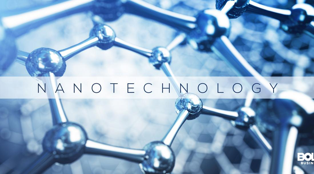 "a photo of the word ""nanotechnology"" with a background of magnified image of a nanotechnology applications material amid nanotechnology research"