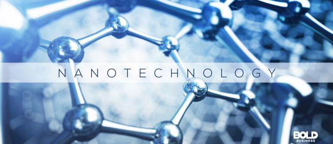 """a photo of the word """"nanotechnology"""" with a background of magnified image of a nanotechnology applications material amid nanotechnology research"""