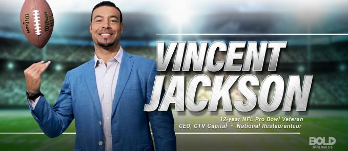 vincent jackson wearing a blue jacket with a football ball above his right hand