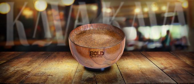 a photo of a Kava drink inside a coconut cup on top of a wooden table in relation to the Kava Craze and Matt Masifilo