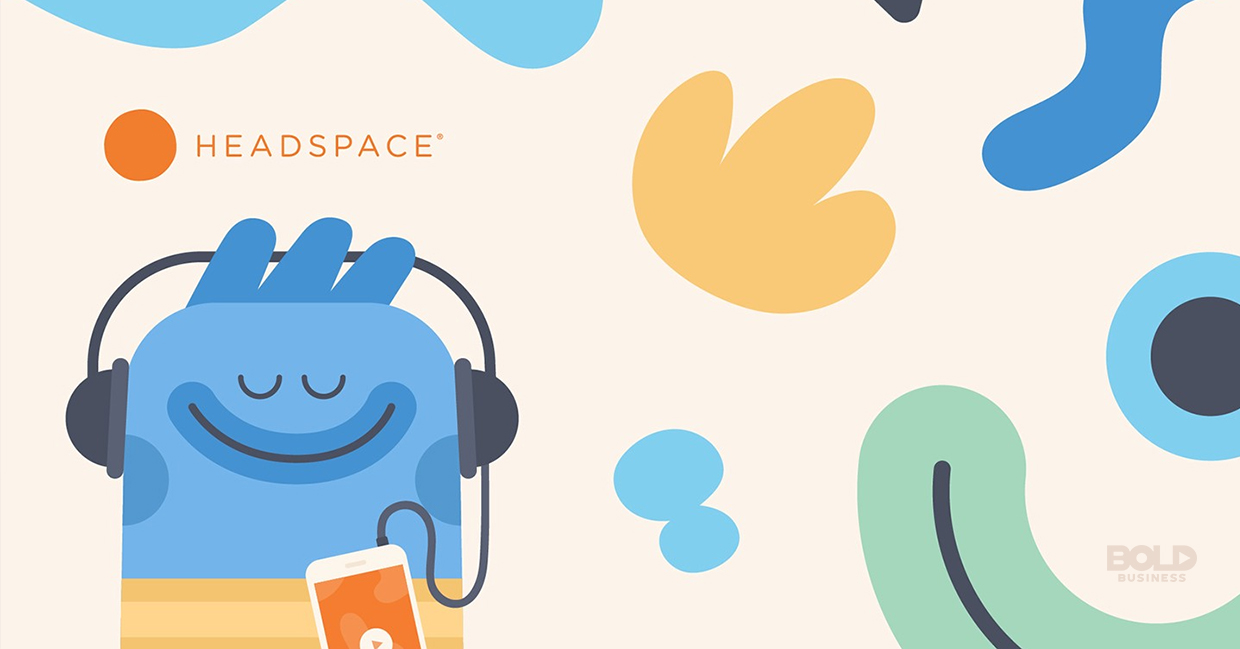 a photo of the Headspace meditation app graphic character listening to the app with its earphones and phone