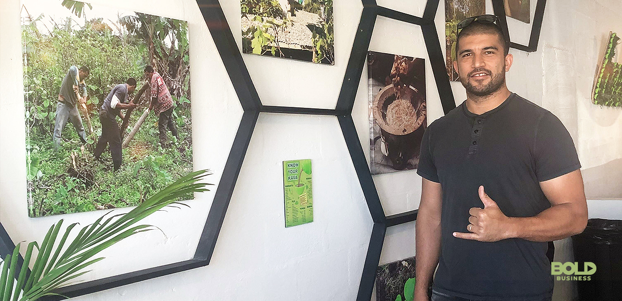 a photo of Matt Masifilo beside a wall full of Kava -related photos