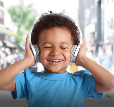 Kid listening to headphones, blocking out sound