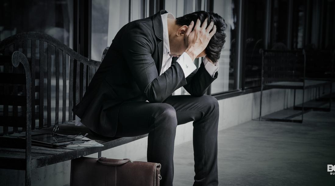 An entrepreneur looking depressed