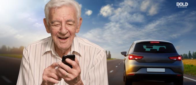 senior medical transportation, old man holding a phone