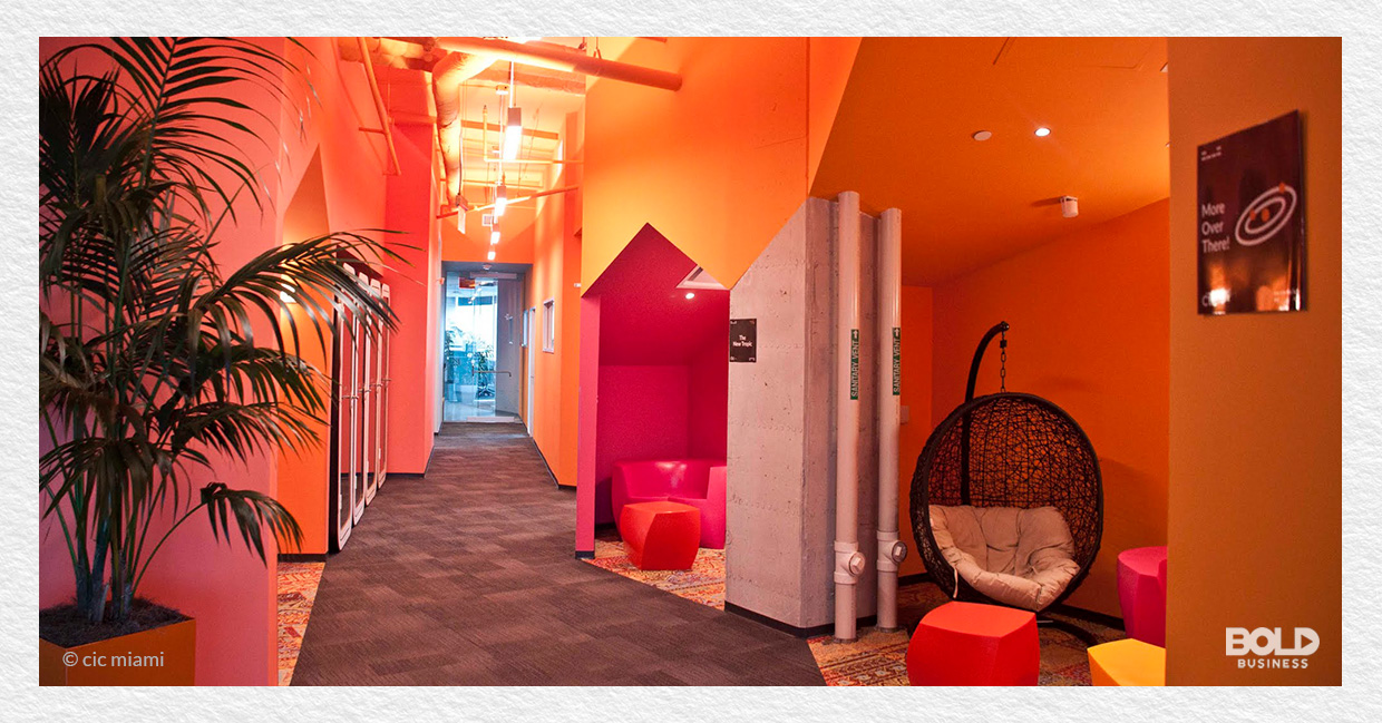 a photo of a pink-and-orange-colored office at Cambridge Innovation Center Miami (CIC Miami), which is led by Natalia Martinez-Kalinina