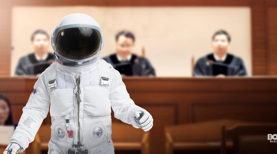 a photo of an astronaut walking away from three judges sitting in front of a courtroom amid the rise of space law cases