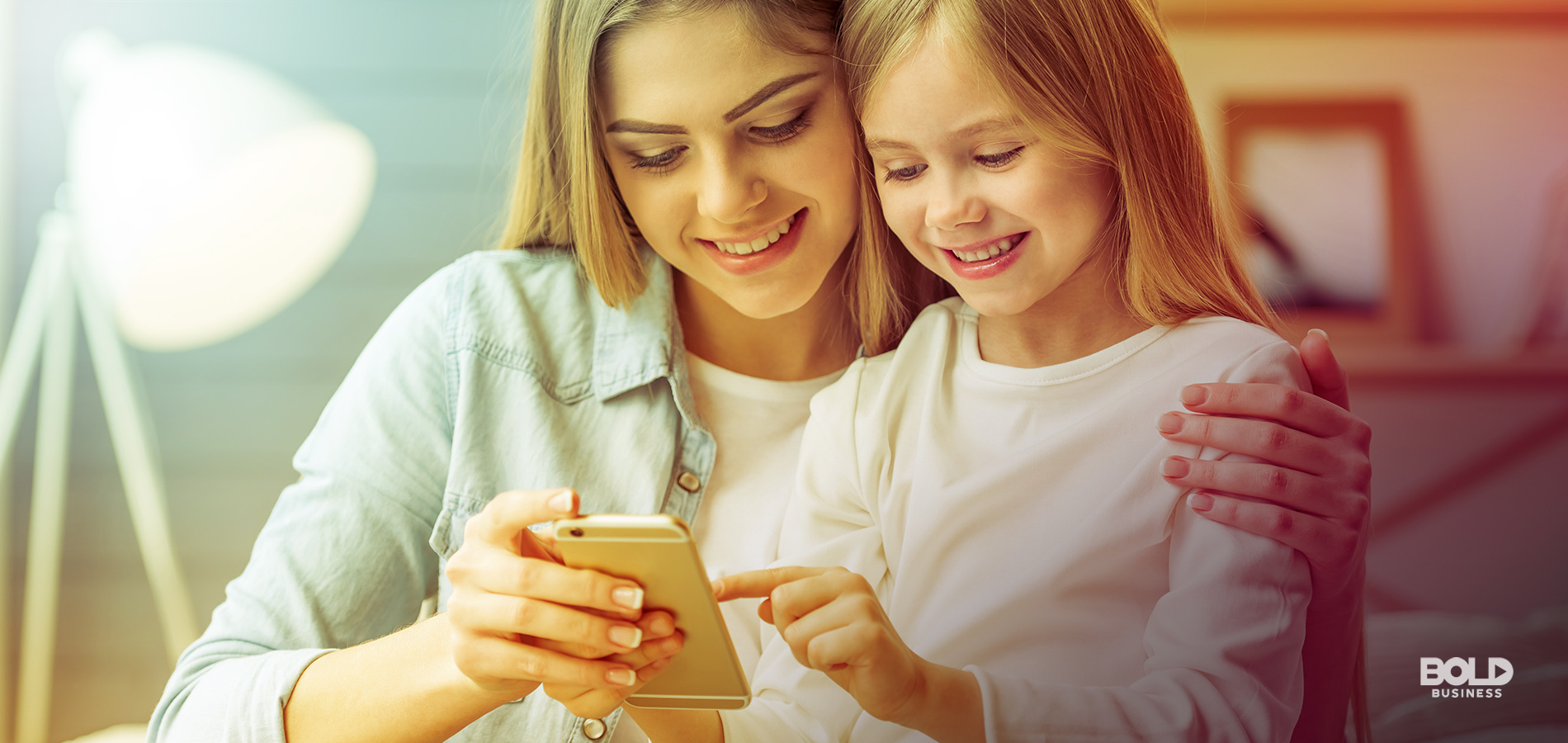 a photo of a young mother with her middle-school aged daughter looking at a smartphone that has several good apps for kids and best apps for kids installed in it