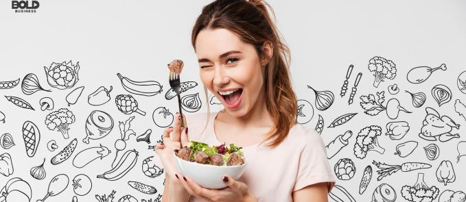 a photo of a woman holding up a fork with a piece of meat and a bolw filled with an assortment of vegetables and meat to depict what a flexitarian diet looks like