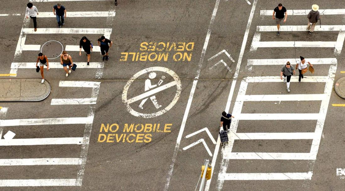 """A """"no mobile devices"""" printed on the street."""