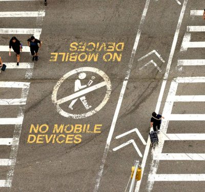 "A ""no mobile devices"" printed on the street."
