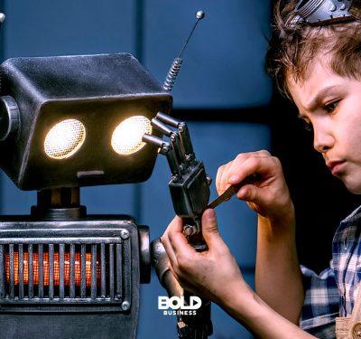 """Robots as friends, a boy fixing his robot """"friend"""""""