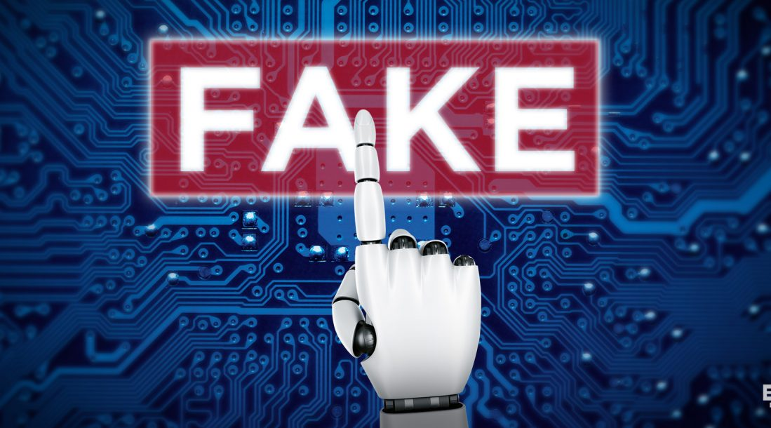 photo of an AI robot's hand pointing to the word FAKE embossed on a magnified part of a microchip amid fake reviews online