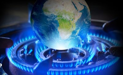 an image of Earth resting atop a lit gas burner amid discussions about banning natural gas to fight climate change