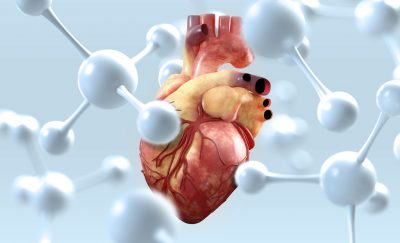 an image of a human heart surrounded by white nanoparticles amid advances in biomedical therapy approaches