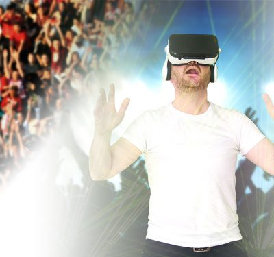 dude wearing VR goggles pretending to be at a sporting event
