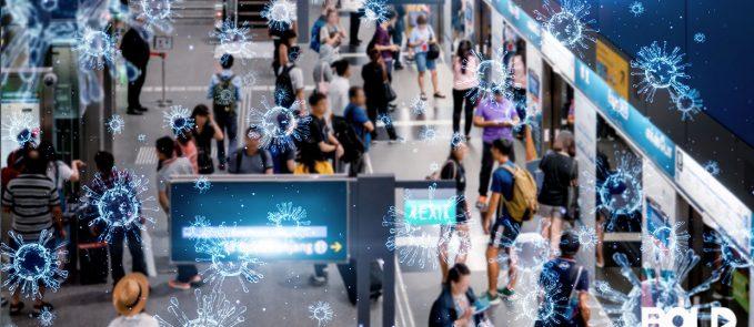 An airport with travelers and coronavirus