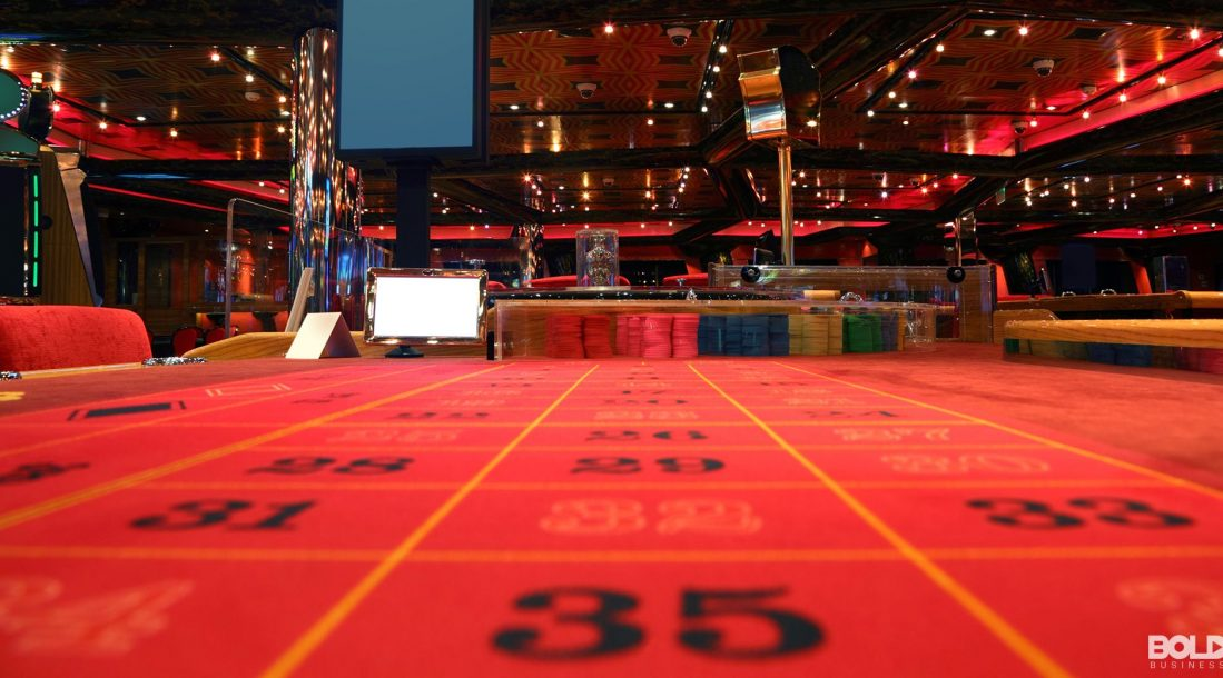 An empty casino view from the felt of a roulette board