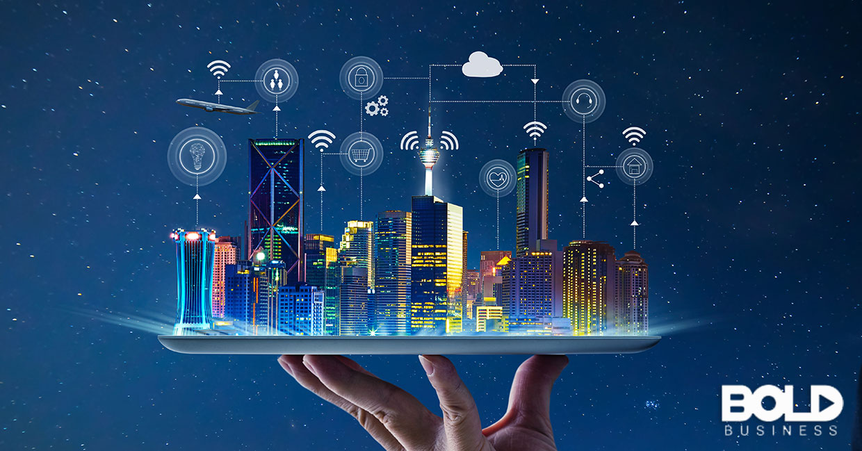 A giant holding a Smart City in their hand