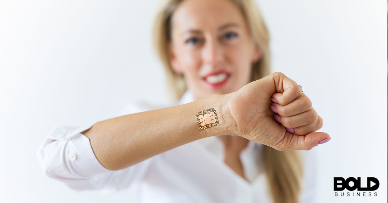 A woman proudly showing off her smart tattoo