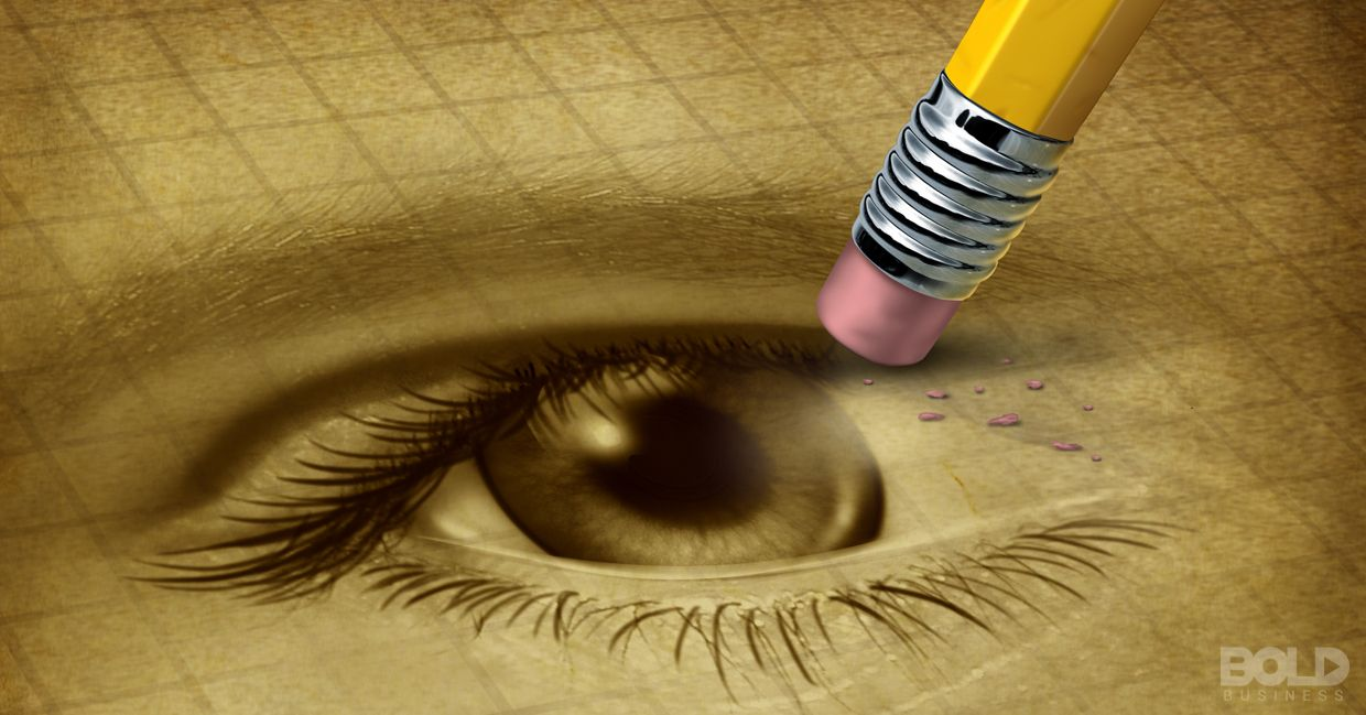 A pencil erasing a drawing of an eye