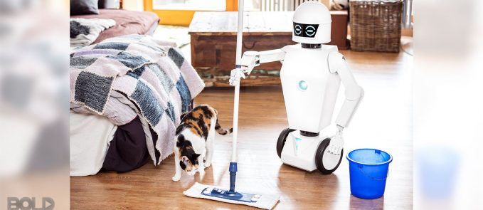 A robot clean up a mess while a pet looks on