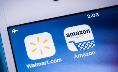 A phone with Walmart and Amazon shopping icons