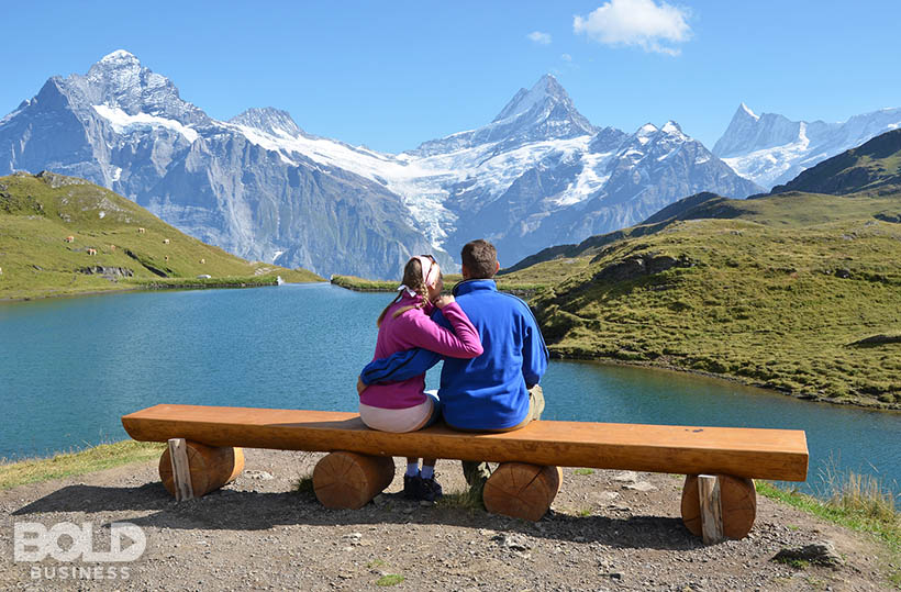 A couple on a bench in the middle of nowhere