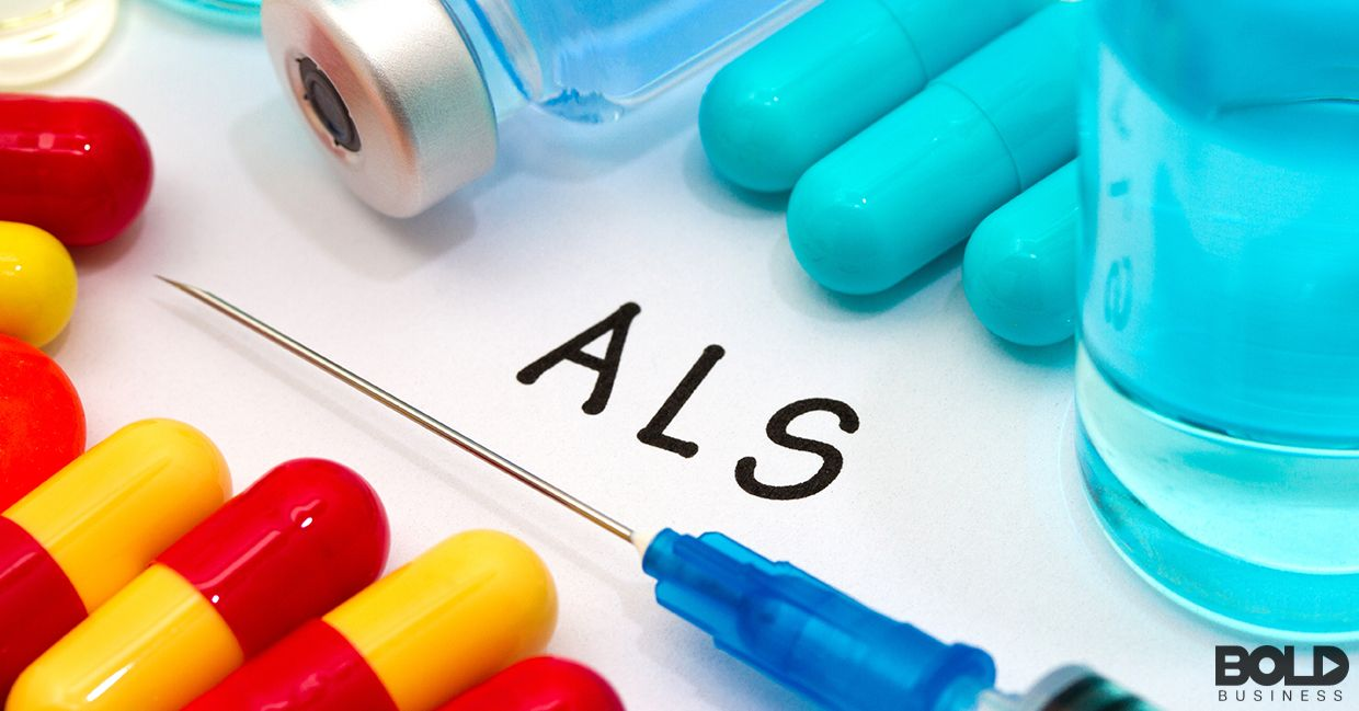 A syringe, some pills and the letters ALS