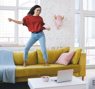 A woman dancing for a live audience on her laptop