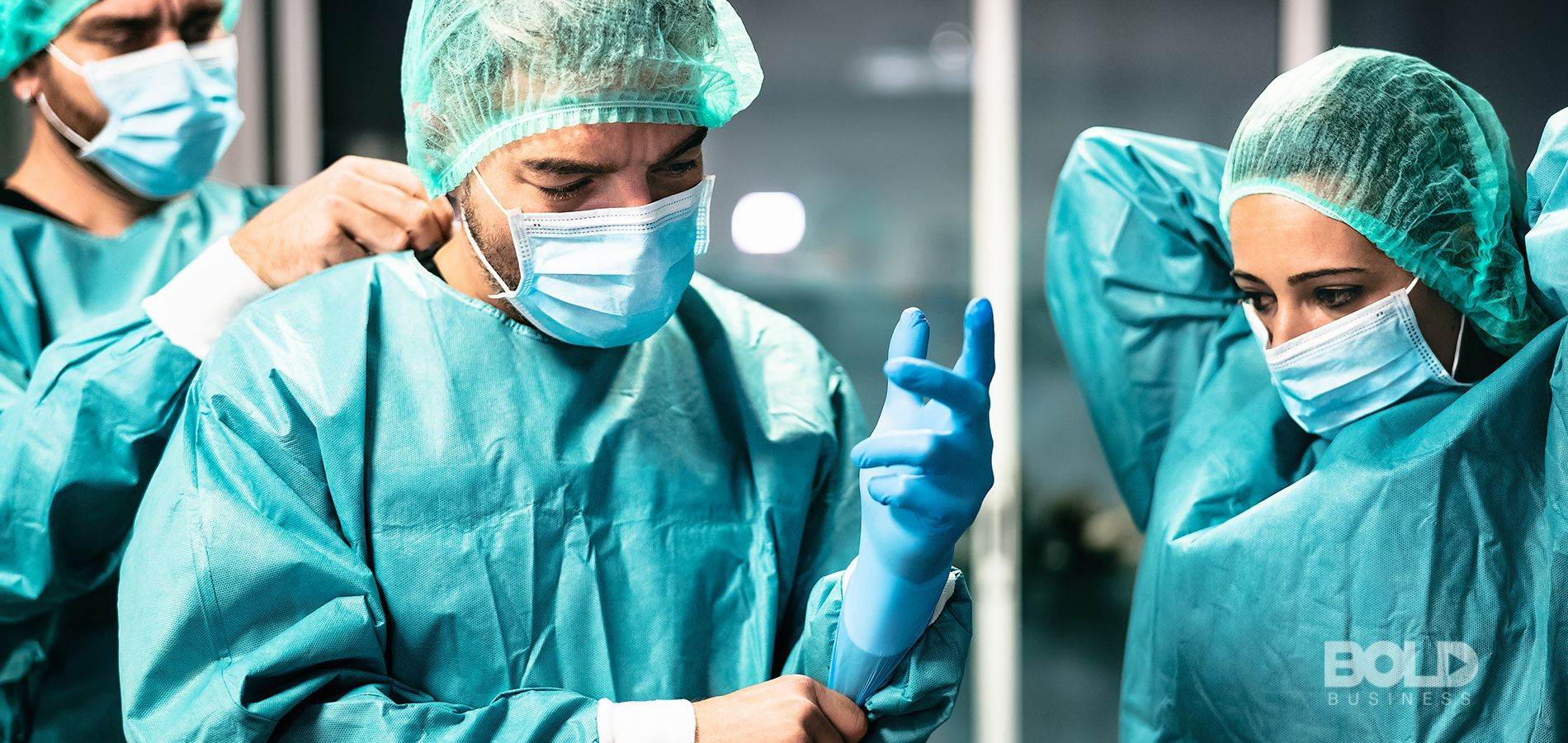 Surgeons in an operating room getting ready to dig in