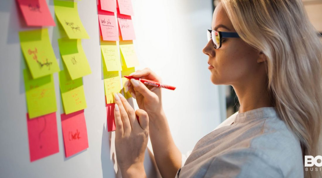 a woman plotting out her business on post-its