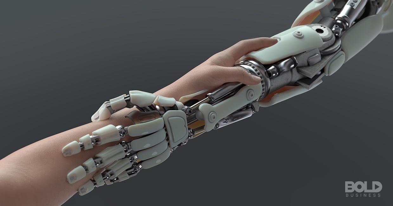 A robotic arm grabbing an organic arm