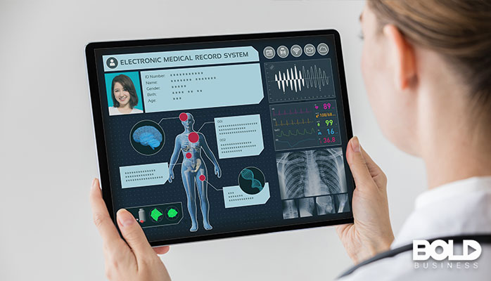 A doctor accessing big data on her tablet