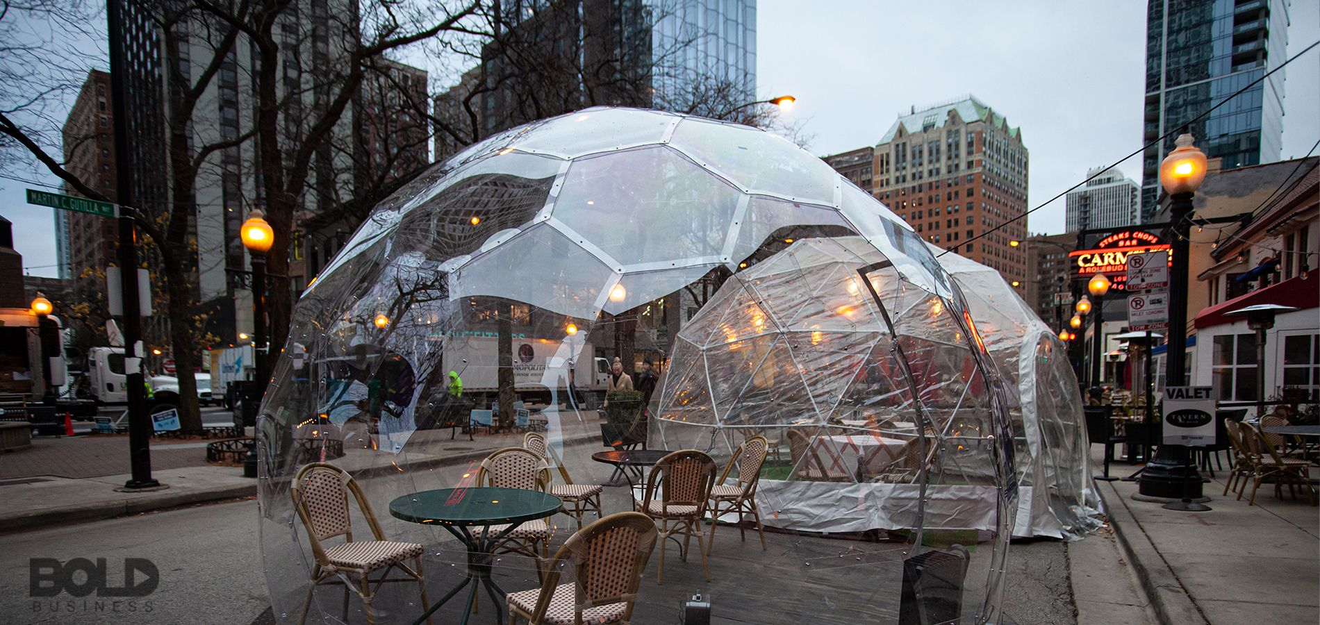 An outdoor table encased in a bubble