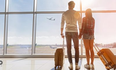 A couple taking a leisure flight, not a business flight