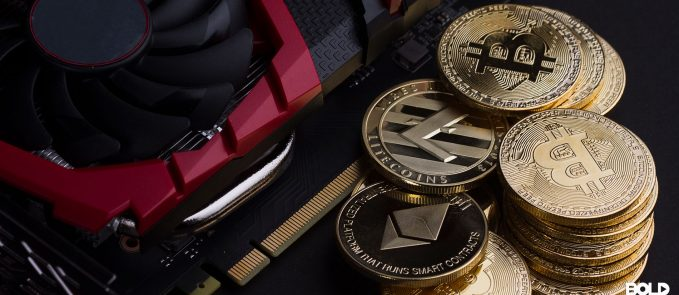 A bunch of cryptocoins next to a car engine