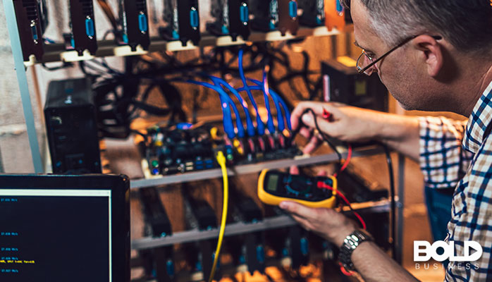 Some dude checking the voltage of some servers