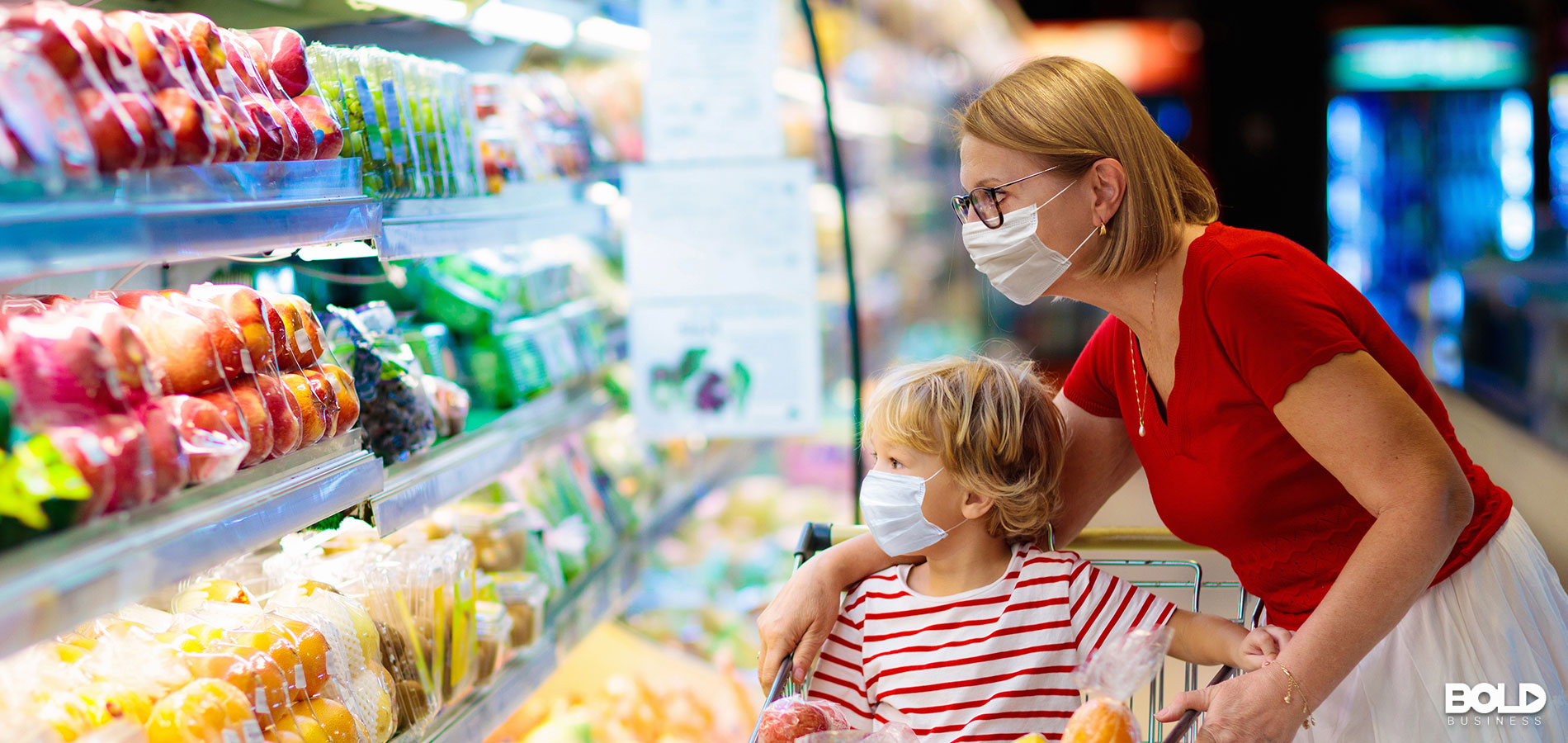 A mom and kid shopping for some delicious groceries