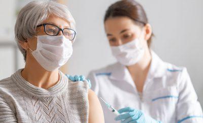 An elderly woman getting the precious COVID vaccine.