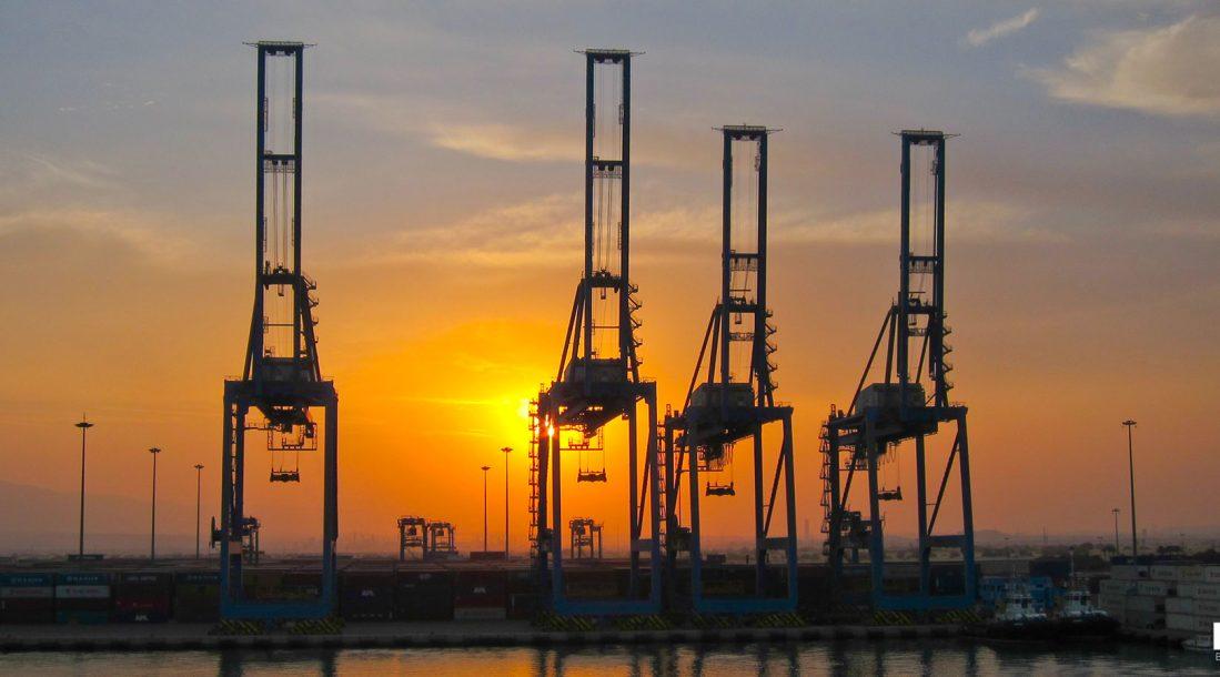 A bunch of cranes at a port