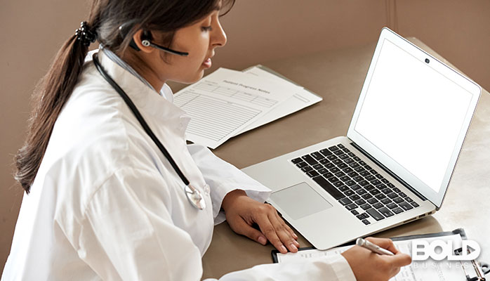 A doctor getting some medical training via her laptop