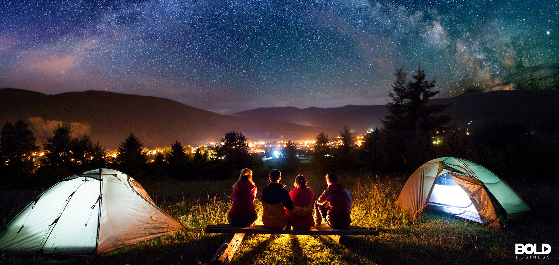 A bunch of people camping under the stars