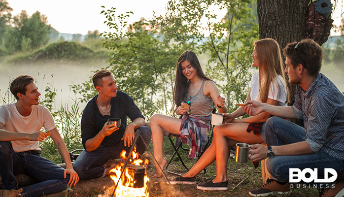 A group of people chilling around a campfire