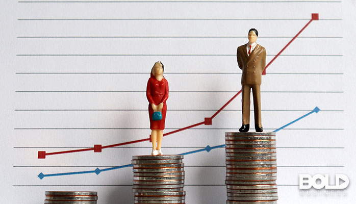 A graph with a woman and man standing on some coins