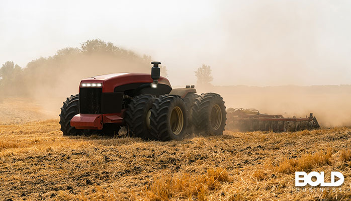 A robotic tractor dragging a plow