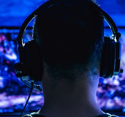 The back of a dude's head as he plays video games