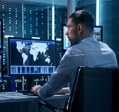 A dude either conducting a cyberattack or protecting against one