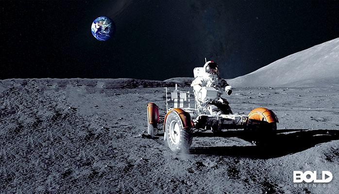 A dude driving his buggy around the moon like a champ